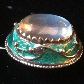 Tiny Arts and Crafts moonstone enamel brooch.