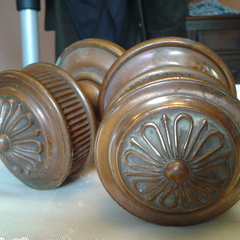 My very heavy, large brass door knobs