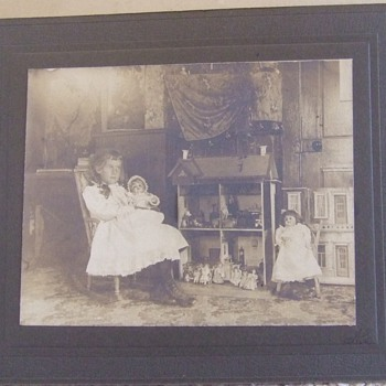 Photograph of Girl with dolls and doll house - Photographs