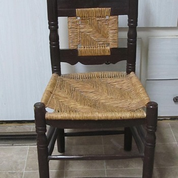 Old looking black wood chair