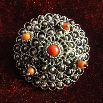 Silver, coral peasant brooch. 