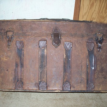 My old trunk, pressed metal with wooden staves that run from back to front. - Furniture