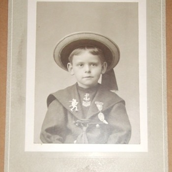 Patriotic boy with Spanish American War support badges