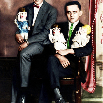 Vintage Postcard 2 men posing with dolls . Circa 1920's? Odd one