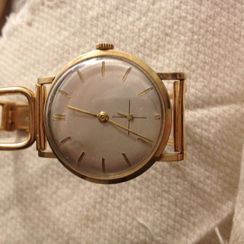 14 k golden watch with golden wrist band