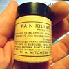 Old jar of Pain Killer Ointment