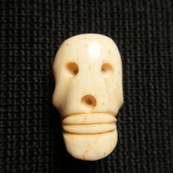 1.6 Inches Ivory carved mini skull pendant(from Africa)