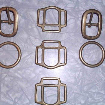 Brass belt buckles and other brass parts.