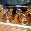 A pair of twin head amber brown glass candlesticks, maker unknown, date unknown