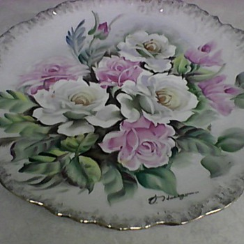 TWO UCAGCO HAND PAINTED PLATES