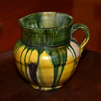 Small pitcher/creamer with drip glaze.