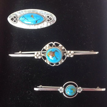 Three Bernard Instone Enamel and Silver Brooches