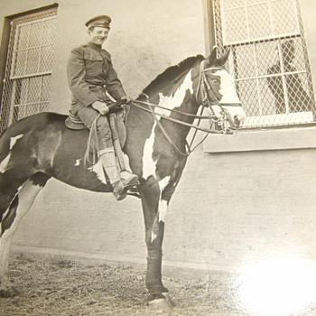 RPPC of early 20th century soldier on horseback