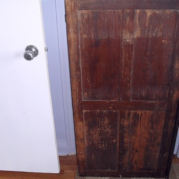 Wood cabinet with brass lock.