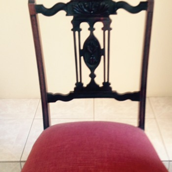 My pair of antique small chairs all four legs on casters