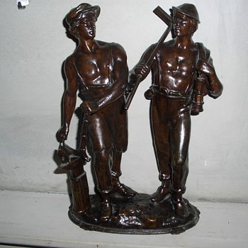 Two workman metal statue