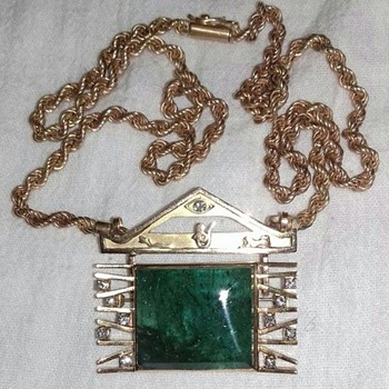Unique Antique 83ct emerald and diamonds set in a 18k gold pendant brooch