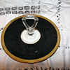 Vintage black round serving tray with gold trim