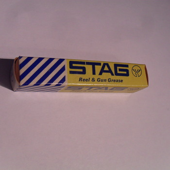 Stag Reel and Gun Grease box. - Sporting Goods