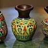 Three little brightly painted pots