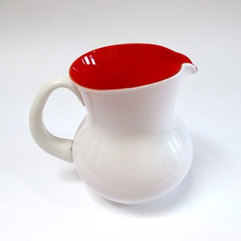 White glass jug with orange interior