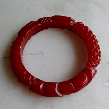 Deep carved translucent ruby bakelite bangle