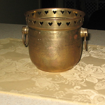 SMALL BRASS POT WITH HEARTS AROUND IT... MADE IN INDIA