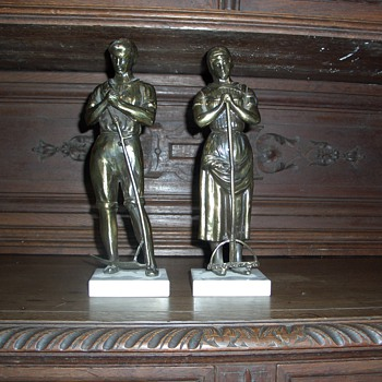 Two workers, metal statues