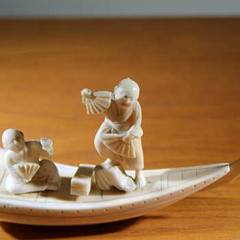 Ivory Boat with two men - Asian
