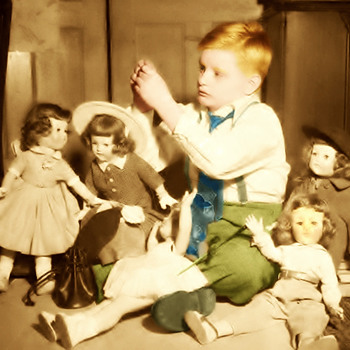 Boy Photographed with Dolls