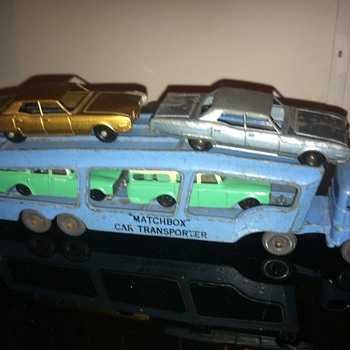 Rare Tootsie Toy Oldsmobile cars on a Matchbox Moko auto carrier.