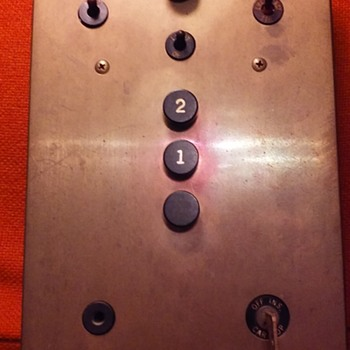 brass elevator control panel