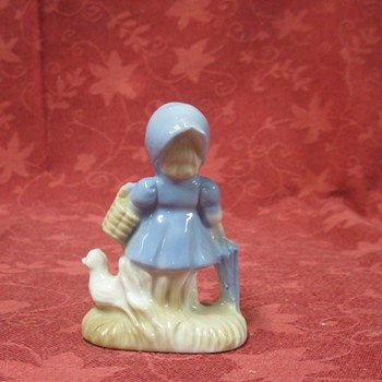 small girl with duck - Pottery