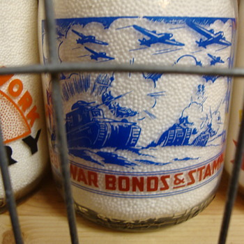 Lots of Tanks & Bomber Airplanes On War Slogan Milk Bottle......
