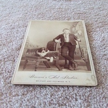 Cabinet card of boy with hunting rifle and dog c. 1885