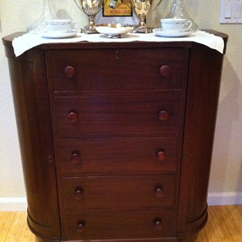 A demilune drawers chest