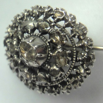Silver round brooch with a lot of rose cut diamonds