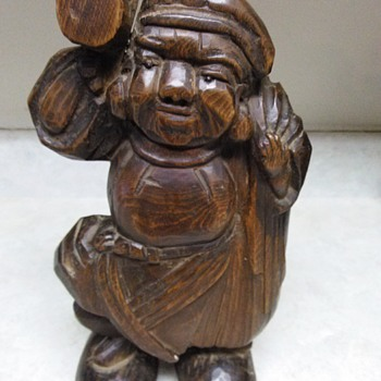 LARGE WOOD CARVING OF A MAN