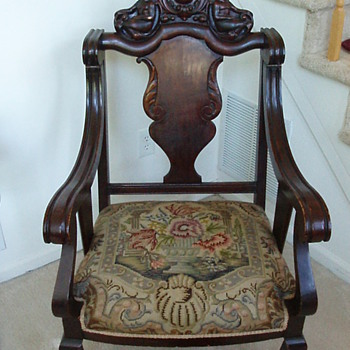 1oo year old arm chair