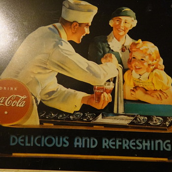 something coca-cola?? if somebody know anything about it please let me know I can't find it anywhere on the web!!! Thanks!! - Coca-Cola