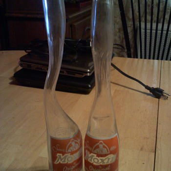  Two  funny looking Moxie soda bottles