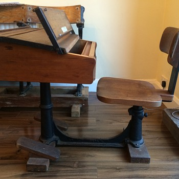 Adjustable school desk with foot rests.