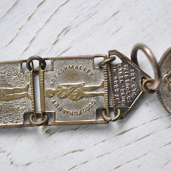 "whimsical antique panel watch fob chain with ""toasts"""