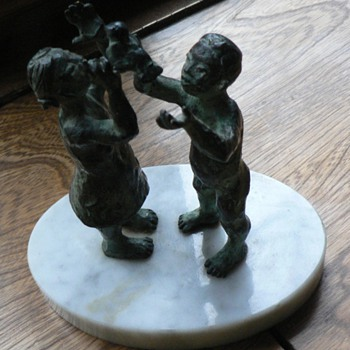 Bronze statue of Girl and Boy holding a Bird