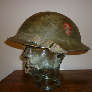 Canadian WWII cammo steel helmet of the Winnipeg Grenadiers.