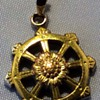 Antique gold ships wheel