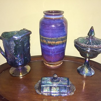 Large purple pottery vase and some carnival glass