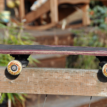Very old skateboard made of laminated wood