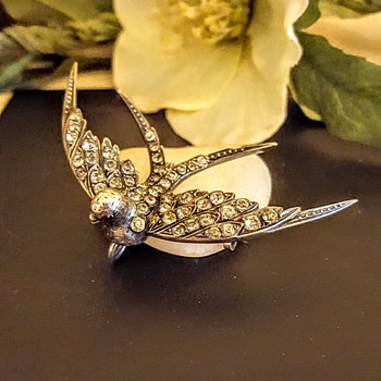 Big Victorian silver and paste swallow.