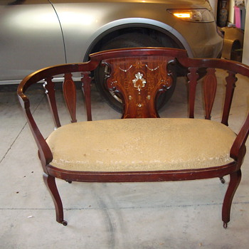 Settee with a mystery to solve   - Furniture